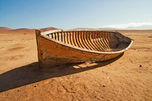 A Broken, Discarded Boat In Th...