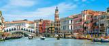 Rialto Bridge over Grand Canal, Venice, Italy. It is a famous landmark of Venice. Panorama of the old Venice city in summer. Cityscape of Venice with colorful houses and tourist boats on sunny day. - 268727181
