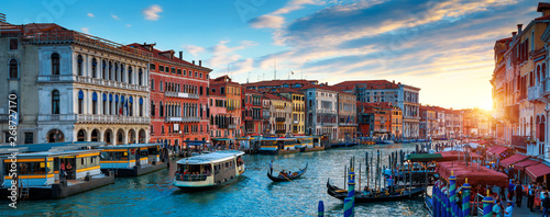 Poster Gondoles Panorama of Venice at sunset, Italy. Scenic view of Grand Canal in twilight. It is a top tourist attraction of Venice. Beautiful cityscape of Venice at dusk. Romantic water trip in Venice in evening.