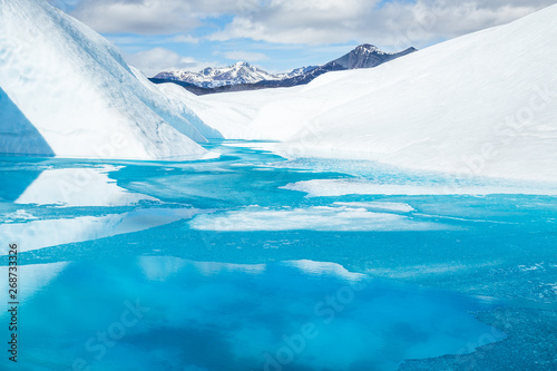 Fotografie, Obraz Frozen pool melting on the surface of the Matanuska Glacier in Spring