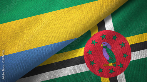 Fotografie, Obraz  Gabon and Dominica two flags textile cloth, fabric texture