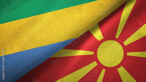 Fotografie, Obraz  Gabon and North Macedonia two flags textile cloth, fabric texture