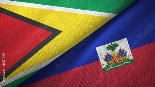 Photo Guyana and Haiti two flags textile cloth, fabric texture