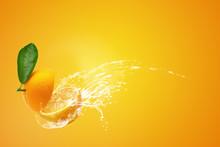 Water Splashing On Fresh Sliced oranges And Orange Fruit On Orange Background