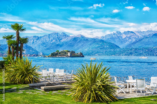 In de dag Golf Outdoor restaurant with beautiful view on Lake Lago Maggiore in the background of the Alps Mountains, Stresa, Italy