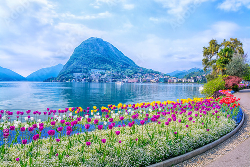 Poster Printemps Beautiful view of the lake surrounded by mountains from the botanical garden of Lugano on a spring day, Ticino, Switzerland