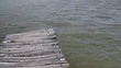 Wooden Dock or Pier in a lake from the POV from the shore