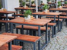 Benches And Tables In Front Of A Restaurant