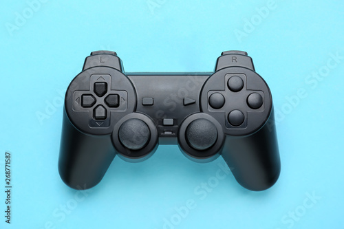 Modern game pad on color background Poster Mural XXL