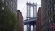 DUMBO BROOKLYN DOWN UNDER BROOKLYN BRIDGE SHOT PANNING UP FROM STREET
