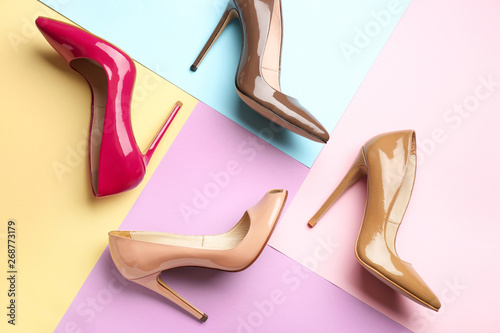 Fotografía  Different stylish high heeled shoes on color background