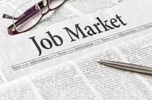 A Newspaper With The Headline Job Market