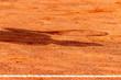 canvas print picture - Tennisspieler mit Schläger Schatten auf rotem Sand, Sport Hintergrund