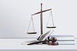 Leinwandbild Motiv Justice Scales and books and wooden gavel on table. Justice concept