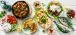 Leinwanddruck Bild - Selection of traditional greek food - salad, meze, pie, fish, tzatziki, dolma on wood background, top view
