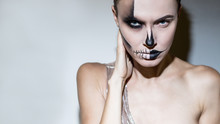 : Halloween Beautiful Woman Bright Black Halloween Makeup Isolated Gray Background