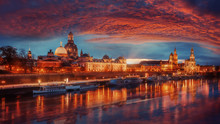 Fantastic Colorful Sunset In Dresden With Dramatic Sky, Over The Elbe River. Old Town Glowing In Lighten Reflected In Calm Water. Picturesque Unusual Scene. Creative Image