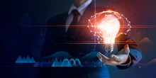 Businessman Holding Light Bulb And Brain Network With Icon Business And Technology, Innovative In Futuristic, Network Connection On Interface Background, Abstract, Innovation And Technologies.