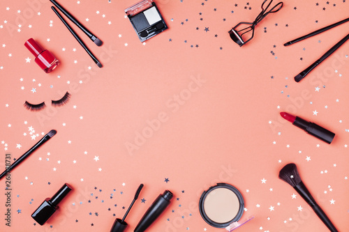 Fotografía Beauty products and cosmetic for woman makeup decorated star confetti on coral table top view