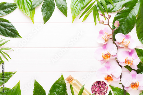 Papiers peints Fleur Beauty and fashion concept with spa set on pastel rustic wooden background.