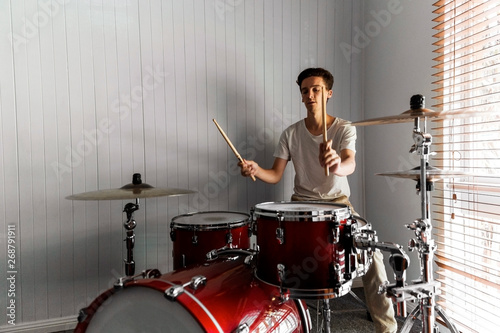 Highly skilled drummer working his magic in domestic practise room Wallpaper Mural