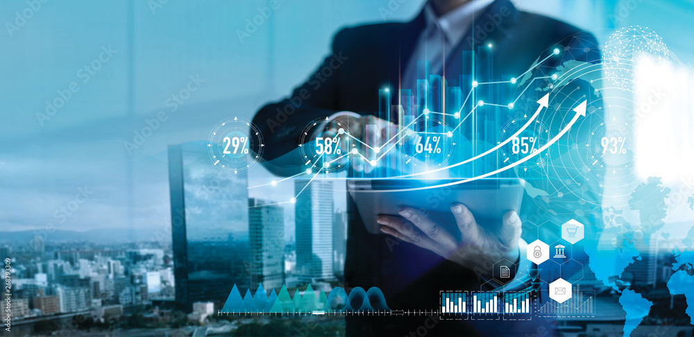 Fototapety, obrazy: Digital marketing. Business strategy. Businessman using tablet analyzing sales data and economic growth graph chart on hologram screen. Business strategy and digital data.
