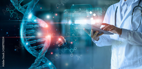 Obraz Abstract luminous DNA molecule. Doctor using tablet and check with analysis chromosome DNA genetic of human on virtual interface. Medicine. Medical science and biotechnology. - fototapety do salonu