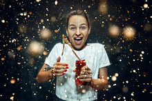 Woman Drinking A Cola At Studio. Young Smiling Happy Caucasian Girl Opening Can With Cola And Enjoying The Spray. Advertising Image About Favourite Drink. Lifestyle And Human Emotions Concept.