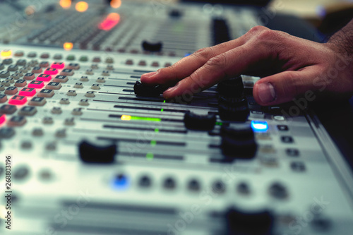 Fotografie, Obraz  Professional audio mixing console with faders and adjusting knobs - radio / TV b