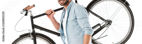 Foto op Plexiglas Fiets cropped view of smiling bearded man holding bicycle isolated on white