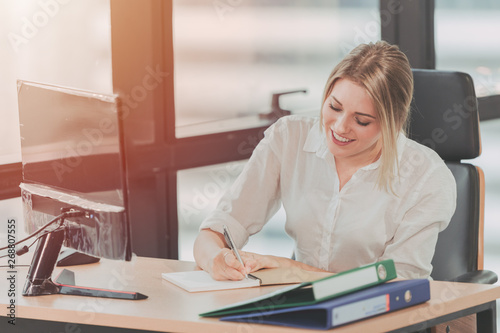Obraz Happy Smile Young Busy Businessgirl Working Busy in Office,Receptionist and Personal Assistant Taking Note vintage color tone - fototapety do salonu
