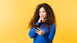 canvas print picture - Internet addiction. Excessive social network use. Young lady holding smartphone, curious about new posts in web feed. Empty space.