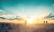 canvas print picture - City day concept: big city at sunset background