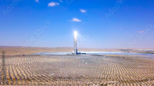 Solar power tower and mirrors that focus the sun's rays upon a collector tower to produce renewable, pollution-free energy, Aerial image