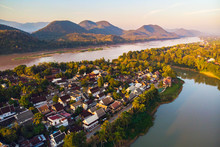 Aerial View Of Luang Prabang And Surrounding Lush Mountains Of Laos. Nam Kahn River, A Tributary Of The Mekong River, Flows Peacefully On The Right.