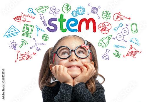 Obraz STEM word and doodles above beautiful cute little girl. modern education concept - fototapety do salonu