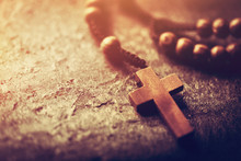 Rosary With Wooden Cross On Stone Background.