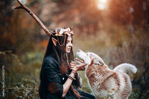 beautiful-elf-woman-fabulous-fairy-forest-famtasy-young-woman-with-long-ears-long-dark-hair-golden-wreath-crown-on-head-with-red-dog-like-wolf