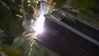 Electric welding of metal frame outdoors