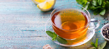 Tea Cup With Mint Leaf And Lemon. Wooden Background. Copy Space.