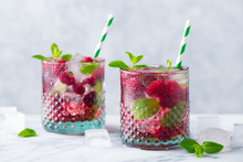 Raspberry Cocktail, Fizz, Lemonade, Ice Tea With Fresh Mint On Marble Background. Close Up.