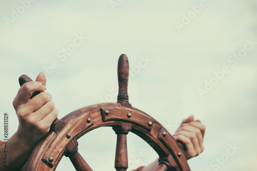 Fotografia  Steering hand wheel ship on sky background
