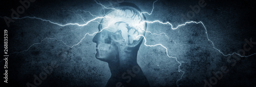 Obraz Silhouette of a man's head with x-rayed head and lightning coming out of the brain. Conceptual idea and symbol of the work of the brain, thinking, power of mind.  - fototapety do salonu