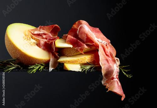 Fotografie, Obraz  Prosciutto with melon and rosemary.