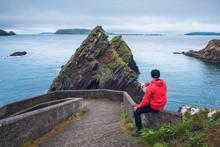 Tourist Watching Giant Cliffs ...