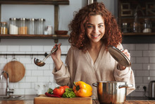 Photo Of Adorable Caucasian Woman Holding Cooking Ladle Spoon While Eating Soup At Home