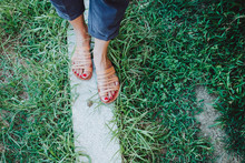 Woman Feet On The Grass And Snail