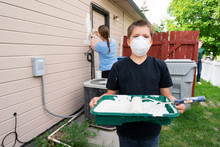 Volunteers Painting A House