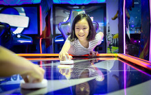 Asian Little Girl Playing Arca...