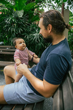 Baby And Father In Garden
